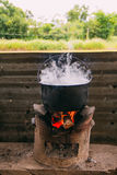 Boil water with stove. By local resident stock photography