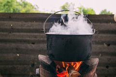 Boil water with stove. By local resident royalty free stock image