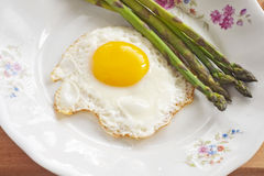 Boiled asparagus and fried egg Royalty Free Stock Photo