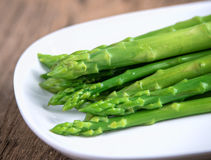 Boiled asparagus on white plate Royalty Free Stock Photo