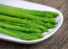 Boiled asparagus on white plate Royalty Free Stock Image