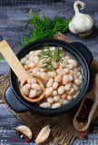 Boiled beans in ceramic bowl Royalty Free Stock Image