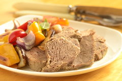 Boiled beef with baked vegetables Royalty Free Stock Photo