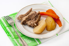 Boiled beef with boiled potatoes and carrots on a plate Stock Images