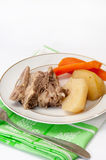 Boiled beef with boiled potatoes and carrots on a plate Stock Image
