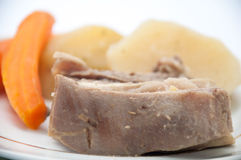 Boiled beef with boiled potatoes and carrots on a plate Stock Photo