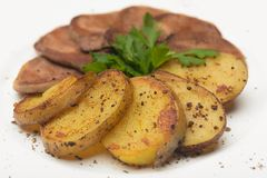 Boiled beef and roasted potatoes Royalty Free Stock Photos