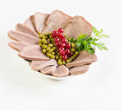 Boiled beef tongue. On white background Stock Photos