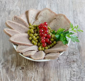 Boiled beef tongue. On wooden background Stock Photography