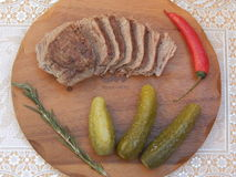 Boiled beef with vegetables. Appetizing slices of boiled beef with pickled cucumber, rosemary and chilli Royalty Free Stock Photos