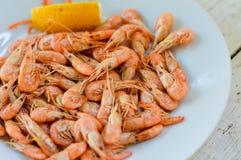 Boiled Black Sea shrimp with lemon Royalty Free Stock Photo