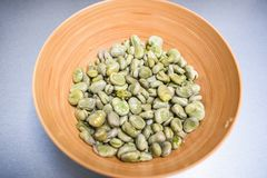 .Boiled broad beans in a bamboo bowl. Boiled broad beans in a bamboo bowl royalty free stock image