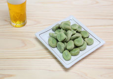 Boiled broad beans with beer Royalty Free Stock Photography