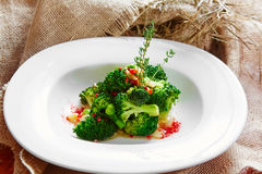 Boiled broccoli in white bowl. On table Stock Photography