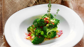 Boiled broccoli in white bowl. On table Royalty Free Stock Image