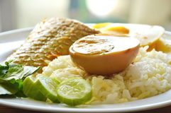 Boiled brown egg with mango fish bamboo shoot in spicy and sour soup on rice. Boiled brown egg with mango fish bamboo shoot in spicy and sour soup on plain rice Stock Photo