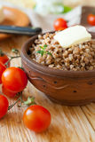 Boiled buckwheat with butter Stock Photos
