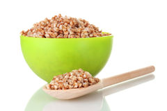 Boiled buckwheat in a green bowl Stock Images