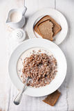 Boiled buckwheat with milk Stock Images