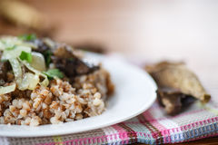 Boiled buckwheat with mushrooms Stock Photo