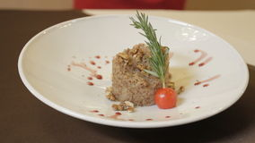 The boiled buckwheat organic is with nuts on a lunch on the table stock video footage