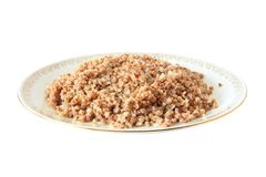 Boiled buckwheat on plate Royalty Free Stock Image