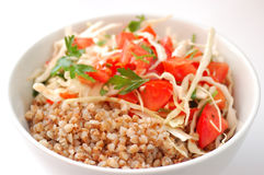 Boiled buckwheat with salad. Boiled buckwheat with tomato salad Stock Images