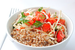 Boiled buckwheat with salad. Boiled buckwheat with tomato salad Royalty Free Stock Photo