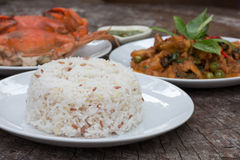Boiled carnaroli rice. Seafood and grilled pork Stock Images