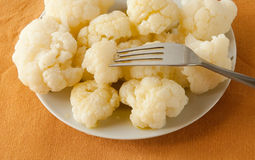 Boiled cauliflower on a plate, served tablecloth Stock Photos