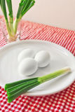 Boiled chicken eggs and fresh spring onion for breakfast Stock Image