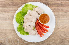 Boiled chicken meat with lettuce, sweet pepper and sauce Stock Image