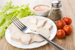 Boiled chicken meat in plate, leaf lettuce, pepper, sauce, tomat Stock Photography