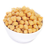 Boiled chickpeas. Closeup of a bowl with boiled chickpeas on a white background Royalty Free Stock Images