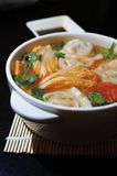 Boiled Chinese Dumplings in Sour Tomato Soup. Together with soy-vinegar dipping sauce Royalty Free Stock Photo