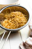 Boiled chinese noodles in colander Royalty Free Stock Photos