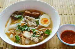 Boiled Chinese pasta with pork and entrails topping creamy egg yolk in soup Royalty Free Stock Image
