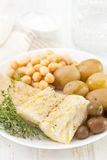 Boiled cod fish with chick-pea Stock Image