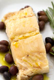 Boiled cod fish with olives Stock Image