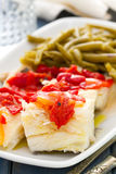 Boiled cod fish with red pepper and green beans Stock Images
