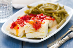 Boiled cod fish with red pepper and green beans Stock Photo