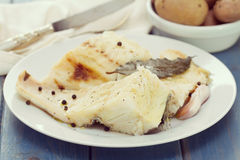 Boiled cod fish on white plate Royalty Free Stock Photography