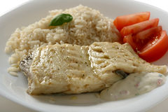 Boiled codfish with rice. And tomato Stock Images