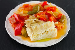 Boiled codfish with vegetables Stock Photos