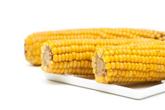 Boiled corn on the cob on a white background Stock Photo
