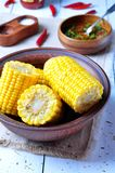 Boiled corn with hot sauce, herbs, salt and spices Royalty Free Stock Image