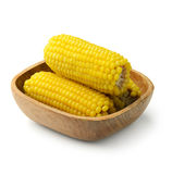 Boiled corn in wodden bowl Stock Photos
