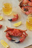 Boiled crabs. And beer on the table Stock Photo