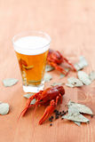 Boiled crawfish with beer Stock Photo