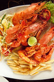 Boiled crawfish with fries Stock Photography